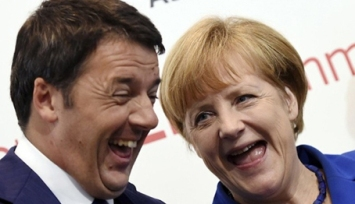 Germany's Chancellor Merkel smiles with Italy's Prime Minister Renzi during the Asia-Europe Meeting (ASEM) in Milan
